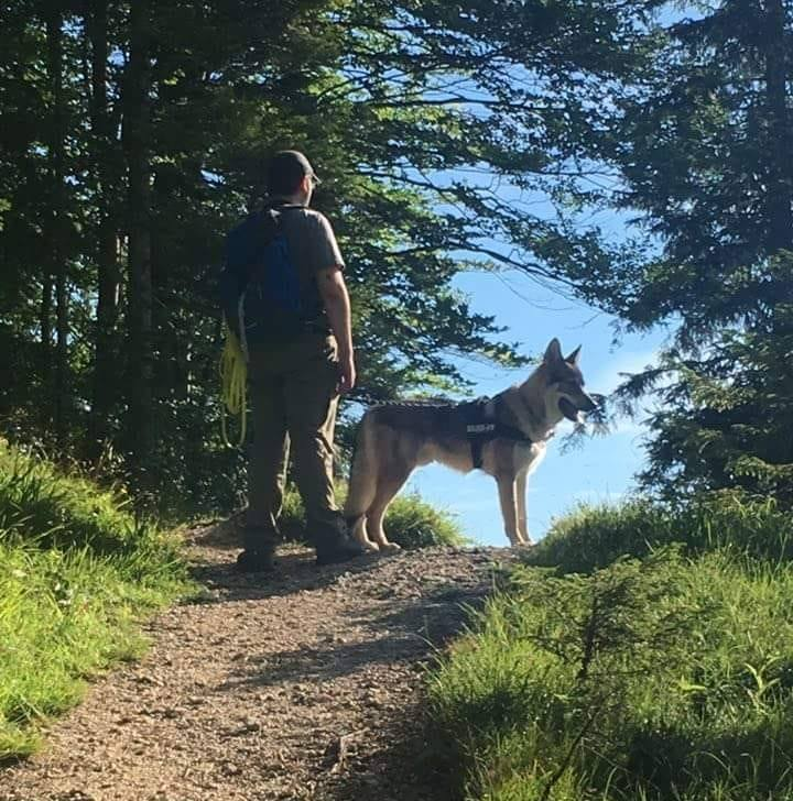 Me together with my dog Newton on a small forest path